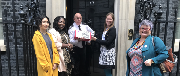 ECPAT UK and Carolyn Harris MP handing over the petition at No 10