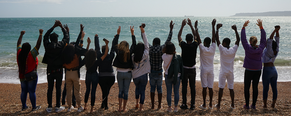 ECPAT UK youth group members on the beach